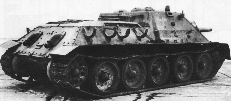 A view of the rear of the captured SU-122. The external fuel tank holders can be seen