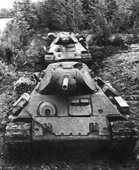 Two T-34 tanks going off-road