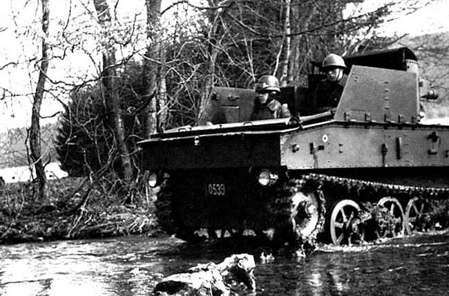 T13 B1 tank destroyer fording a stream. The gun is pointing backwards.
