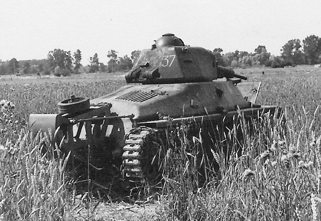 Rear view of a French Army Hotchkiss H35 tank in a field of wheat