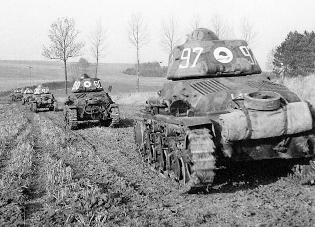 A troop of French Army Hotchkiss H35 tanks on patrol.