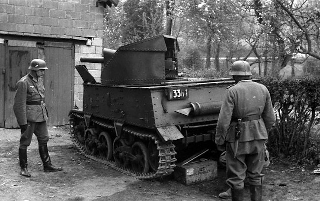 Two German soldiers looking at a captured Belgium Army T13 B3 Tank Destroyer