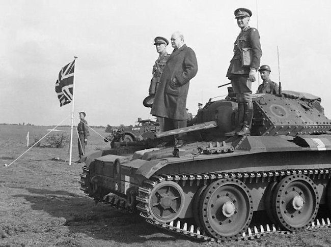 Prime Minister Winston Churchill standing on top of a Covenanter tank.