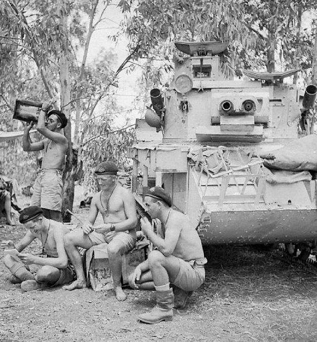 Australian Vickers Mk.VIb tank crews taking a rest in the desert