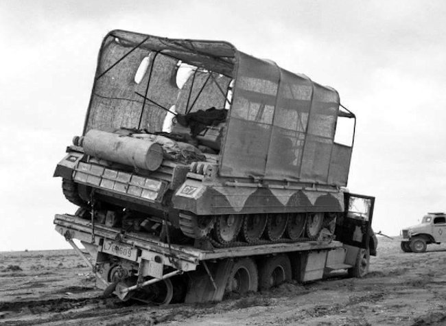 Operation Bertram Crusader Tank on the back of a lorry stuck in the sand