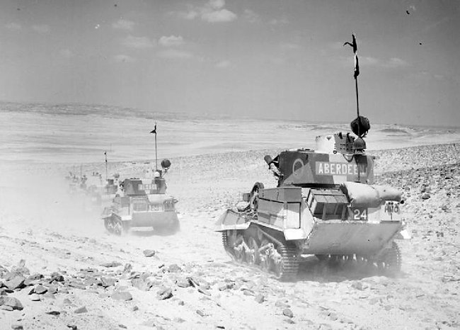 Vickers Mk.VIb Light Tanks of 7th Armoured Division on patrol in the desert, 2 August 1940.