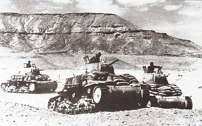 M13/40 Italian tanks on patrol in North Africa