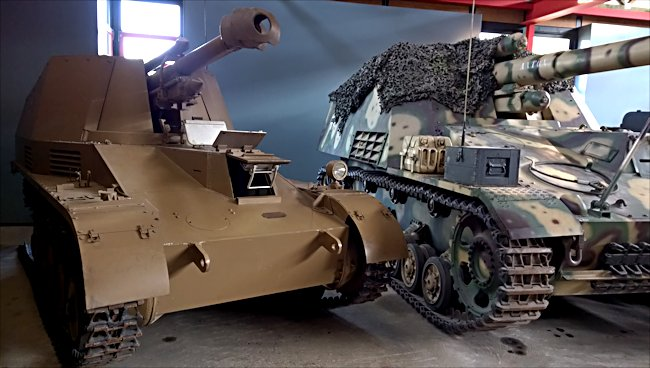 Wespe 10.5cm SPG on the left next to the larger Hummel 15cm SPG at the Deutsches Panzermuseum, The German Tank Museum in Munster, Germany