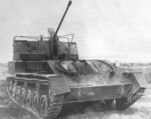 A ZSU-37 with the tarpaulin supports visible.