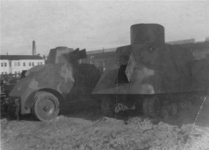 A rear view of what appears to be an Izhora Bronetraktor, next to an Estonian Arsenal Crossley armored car. The suspension of this vehicle would suggest that it is a NI, but it is actually a different vehicle.