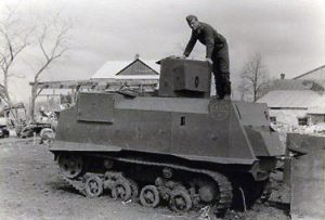A photograph of a NI with an unknown turret, speculated to be an improvised turret - this turret appears totally cylindrical and is facing 7 o'clock in this photograph. A Romanian soldier stands on top.
