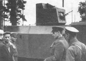 Workers present a NI tank with what appears to be some kind of long DT, believed to be a DT-29 with a flash hider. The turret is taken from a T-26 Model 1931 and reportedly would have had a 37mm PS-1 gun; it appears as though it has been removed and replaced with a DT