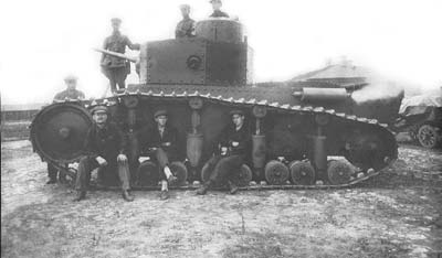 A T-12 is posed on by workers and officers. The eight sided turret is very clear in this image