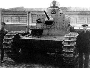 A T-12 outside a factory
