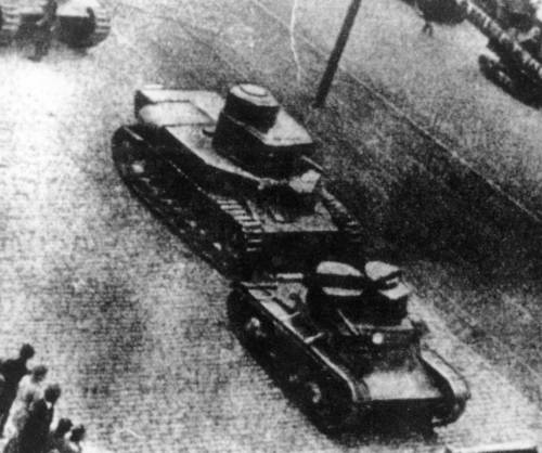 A T-24 on a parade behind a twin-turreted T-26 Mod. 1931