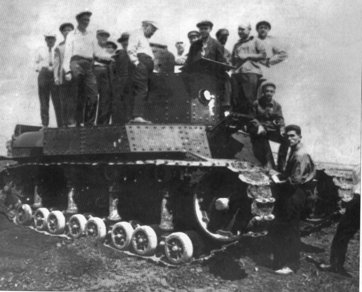 The T-24 is examined by a team of workers and officers. The 45 mm gun was not ready in time for trials, so the tests took place without a gun