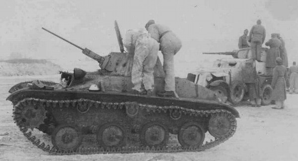 A Soviet crew prepare their winterized T-60. A BA-10 is in the background.
