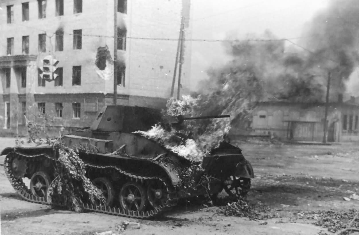 A T-60 burns in a street. The armor was simply too poor.