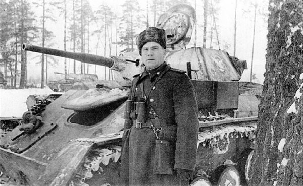 The Commander of the 8th Self-Propelled Artillery Brigade next to a T-70.