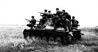 A T-70 being ridden into battle.