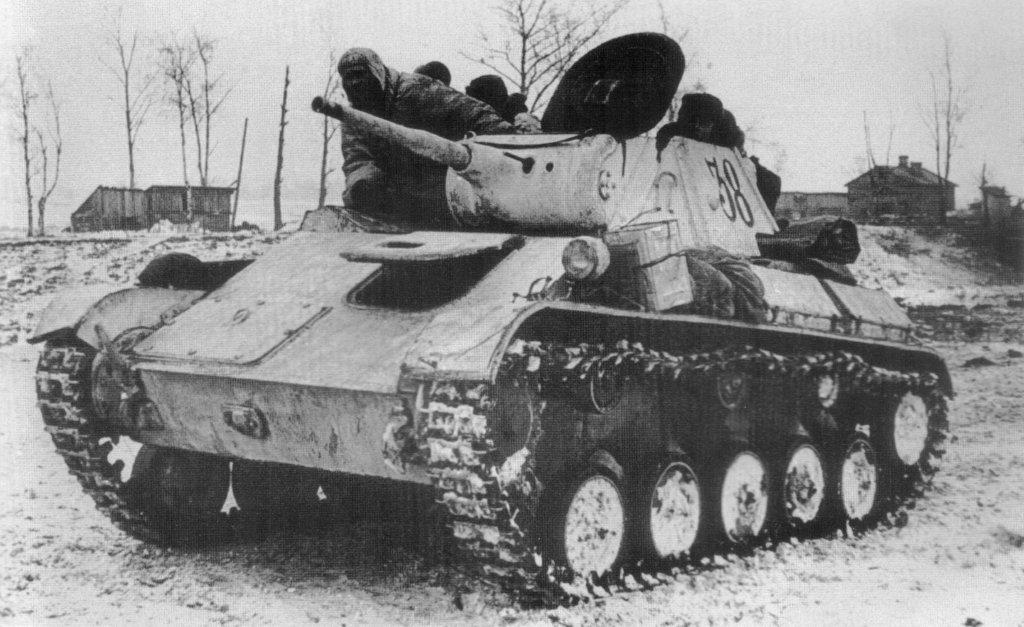 A winterized T-70 is prepared by its crew.