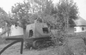 An interesting photo shows a KhTZ-16 being inspected by a Romanian soldier. It appears as though there was a large internal explosion which blew the rear hatch off