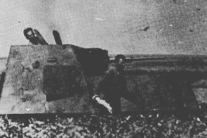 A rather poor quality photograph apparently shows a Soviet crew abandoning a KhTZ-16