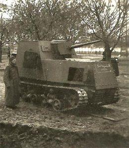 A Romanian soldier poses next to a broken down KhTZ-16