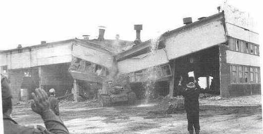 An ISU-152 knocks down a building at Chernobyl, 1984.