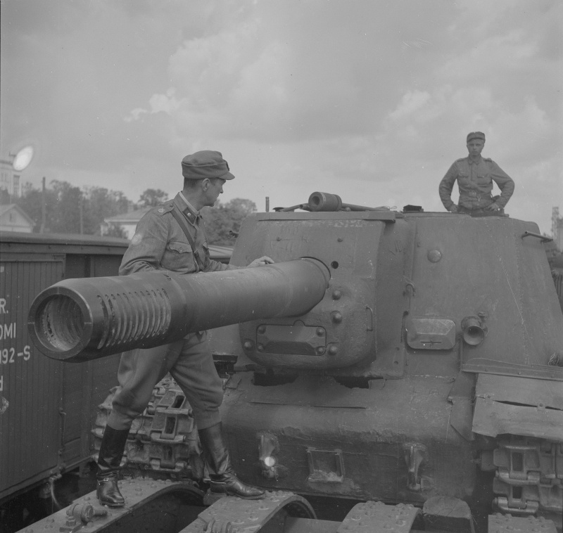 Finnish troops prepare a captured ISU-152 for rail transport.
