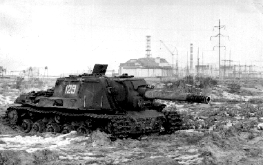 An abandoned ISU-152 with the Chernobyl nuclear facility in the background. This tank is far too irradiated for further use.