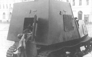 A knocked out KhTZ-16, supposedly near the Kharkov central department store. The charred corpse of a crew member can be seen hanging from the back, possibly killed by an engine fire