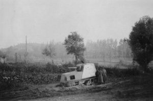 Another broken down KhTZ-16 is inspected by Romanian troops in a rural area
