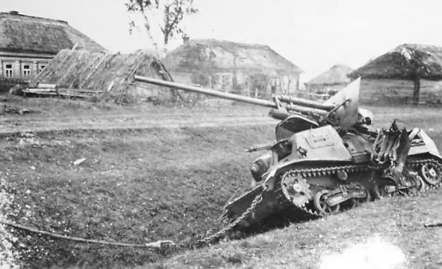 A knocked out ZiS-30 in a rural village.