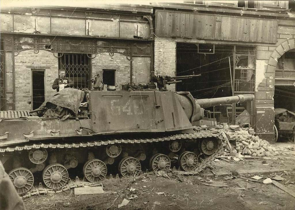 A knocked out ISU-152 in Berlin. The main gun has been shot by a Panzerfaust, and it appears as though the hull was hit by numerous rounds, too.