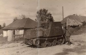 A broken down KhTZ-16 is inspected and posed on by Romanian troops