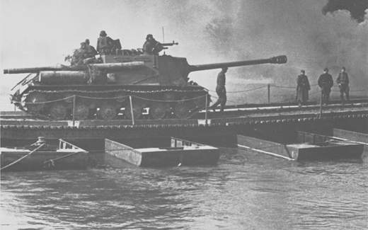 An ISU-122S crosses a pontoon bridge