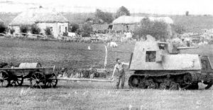 A KhTZ-16 on a farm is inspected by a local. He may be salvaging parts for local partisans.