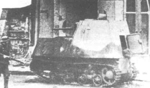 A German soldier looks at an abandoned KhTZ-16. There appears to be a dead crew member hanging from the rear hatch, and may be the same tank as the one reportedly outside the Kharkov central department store