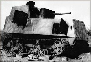 This KhTZ-16 has had its ammunition unloaded, possibly after a breakdown. All hatches on the vehicle are clearly open. The vehicle also appears to be camouflaged.