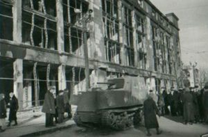 Another view of the broken down KhTZ-16 being inspected in Kharkov