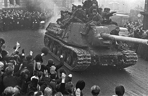 An ISU-122 passes through a parade in Lodz, Poland, 1945