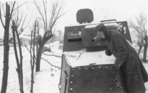 Now that some rivets are missing, this Romanian soldier is inspecting this abandoned KhTZ-16's engine compartment