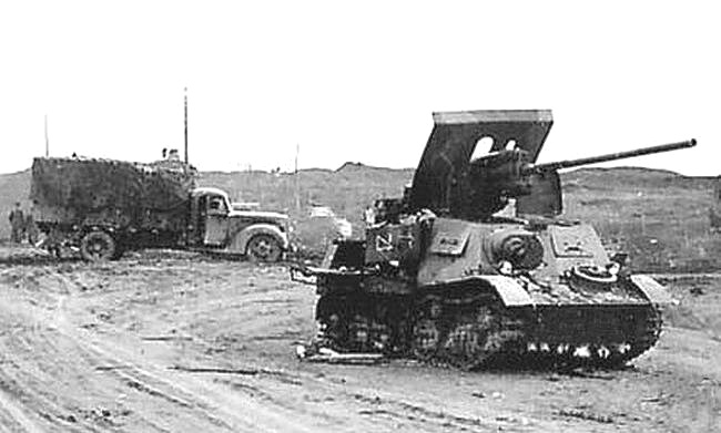 Another knocked out ZiS-30 as part of a column.
