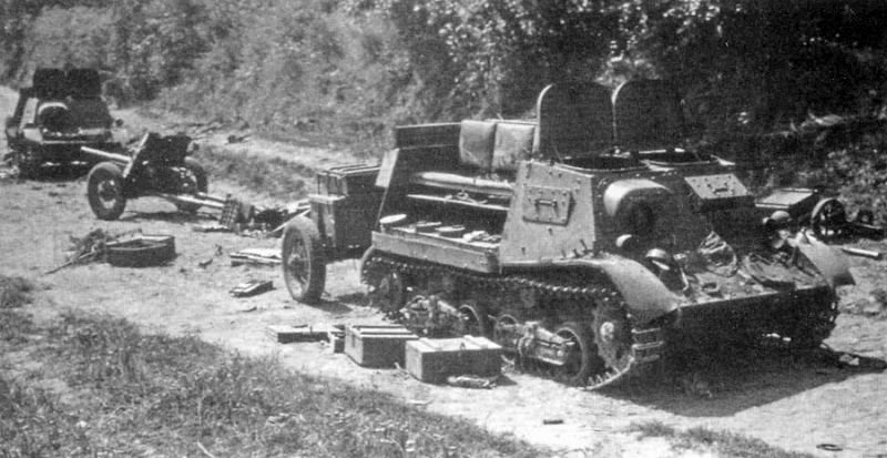 A pair of abandoned Komsomolets with their loads strewn across the road