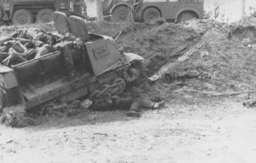A knocked out Komsomolets used as an APC. The passengers lie dead on top and beneath it.