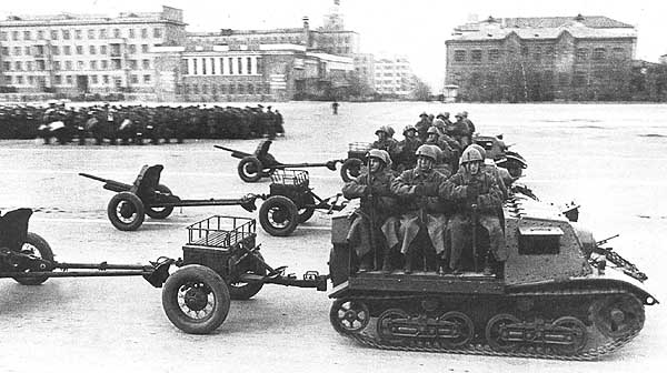 Some Komsomolets on parade with a second limber for ammunition