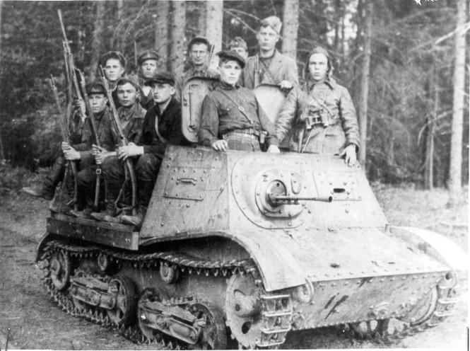 A group of partisans use a Komsomolets as an APC