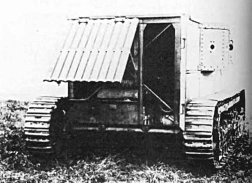 A rear view of the Holt gas-electric, showing the engine access door on the left and the crew door on the right - Source: Public Domain, as taken from Landships.info