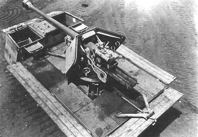 The sides of the Raupenschlepper Ost (caterpillar tractor east) SPG folded down to produce a larger platform for the crew of the 7.5cm Pak 40 gun.